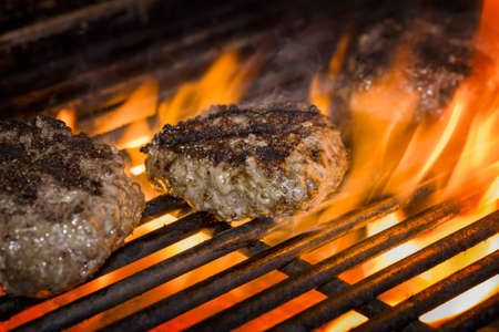 Premium beef burgers flame broiled on a gas grill