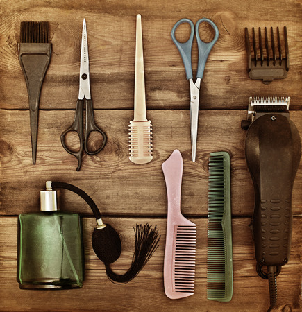 Hairdressing accessories. Retro concept. Scissors and combs on a wooden table. toning