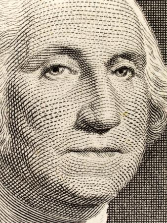 Stock macro photo of a United States one dollar bill, featuring George Washington.