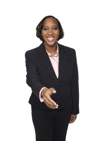 Isolated studio shot of a businesswoman reaching out to shake hands.