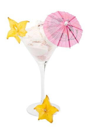 Ice-cream with slice of carambola in a glass on a white background.