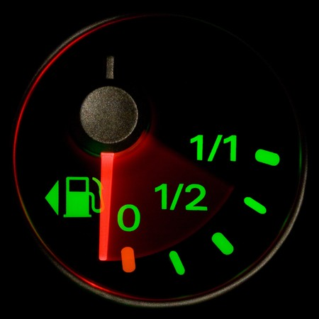 A gas gauge shows petrol level on a black background