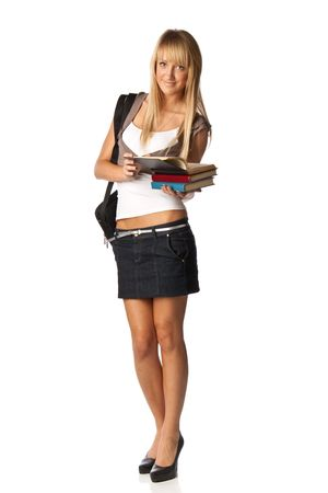 The attractive student stands with books and a bag on a white background. The student.