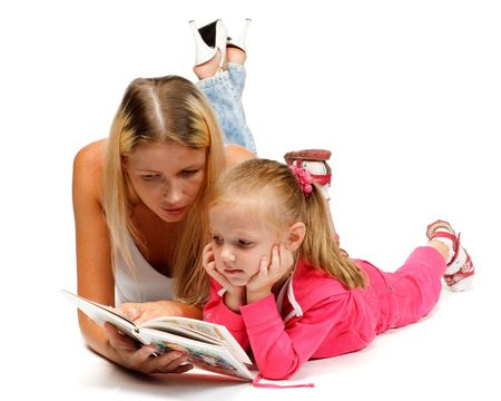 Young mum reads the interesting book to the daughter on a white background.