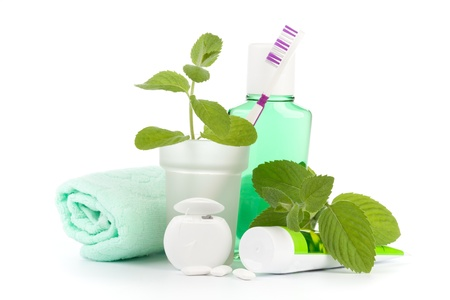 Photo pour Toothbrush with toothpaste and fresh leaves of mint  on a white background. - image libre de droit