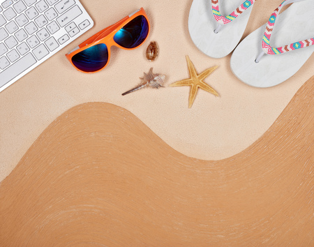 Still life with flip flops, sunglasses, seashells and computer keyboard  lying on textural double background consisting of two beige shades. Top view with copy space, Travel agency. Internet shop