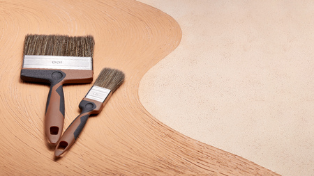Foto de Paint brushes on textural double background consisting of two beige shades. Top view with copy space, Concept of construction or design office - Imagen libre de derechos