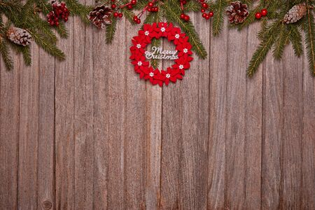 Foto de Wooden vintage background with fir tree branches and Christmas ornaments. Top view with copy space. New Year and Christmas,  For greeting card or advertising - Imagen libre de derechos