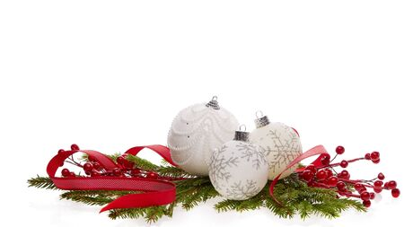 Photo pour Still life with white sparkling balls, red ribbon  and fir branches isolated on a white background. New Year and Christmas decorations - image libre de droit