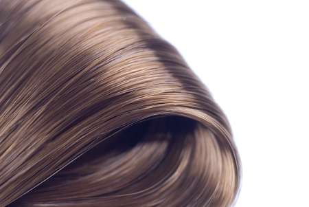 Photo pour Lock of silken brown hair isolated on white background  - image libre de droit