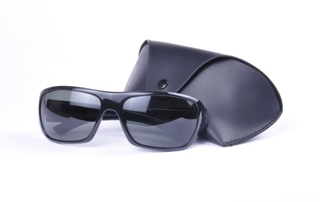 Sunglasses and carri case isolated against a white background