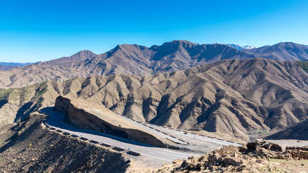 Curved road in Tizi n Tichka mountain pass in the Atlas Mountains. Road to the Sahara desert. Travel concept. High Atlas, Morocco