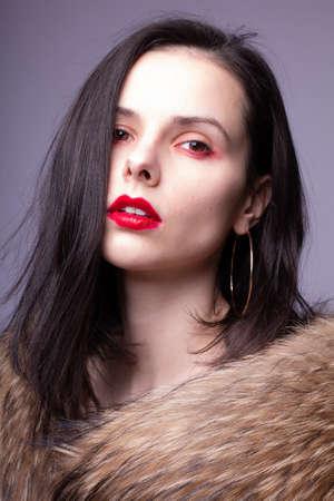 Photo pour woman in furs, clean skin, red lips, expensive - image libre de droit