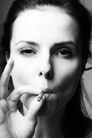 Photo for brunette woman smokes a cigarette - Royalty Free Image
