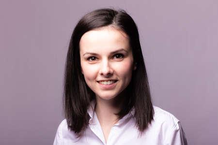 Photo pour beautiful woman manager, office style, gray studio background - image libre de droit