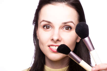 Photo for attractive girl does makeup, makeup brush - Royalty Free Image