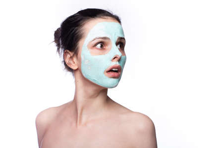 Photo pour Woman in cosmetic mask on her face - image libre de droit