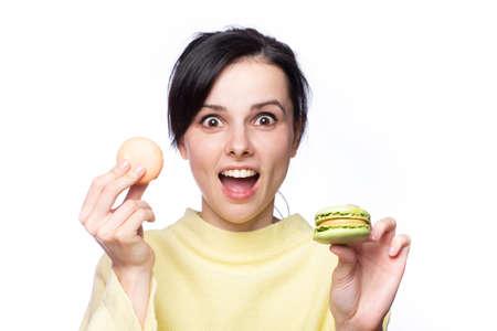 Photo pour Close up profile of charming woman want to bite tasty  macaron - image libre de droit