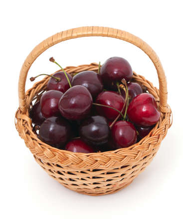 sweet cherry in a basket over white