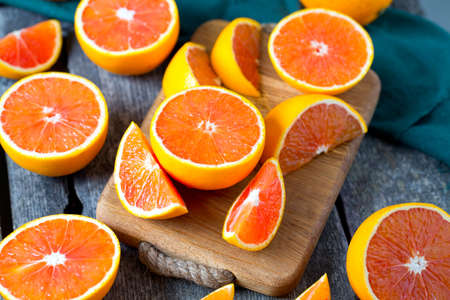 red oranges on wooden surface