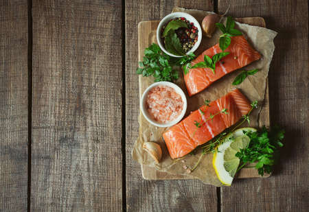 fresh salmon fillet on brown wooden surface: Royalty-free