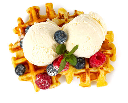 Photo pour belgian waffles with ice cream and berries - image libre de droit