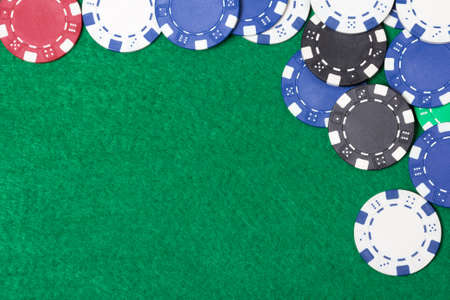 poker chips on a green casino table background