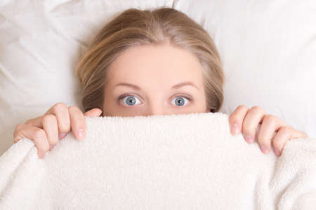 Photo for funny young beautiful woman lying in bed under blanket - Royalty Free Image