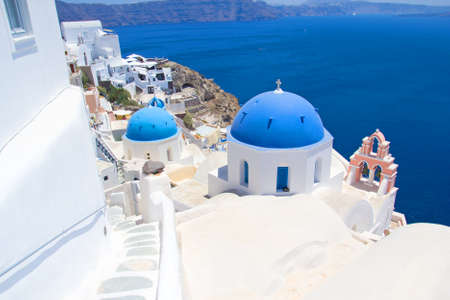 romantic and beautiful Santorini island with blue roofs in Greece