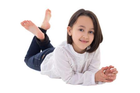 little beautiful girl lying isolated on white background