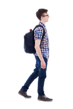 handsome teenage boy with backpack walking isolated on white backgroundの写真素材