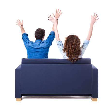Prime Back View Of Young Cheerful Couple Sitting On Sofa Isolated Ocoug Best Dining Table And Chair Ideas Images Ocougorg