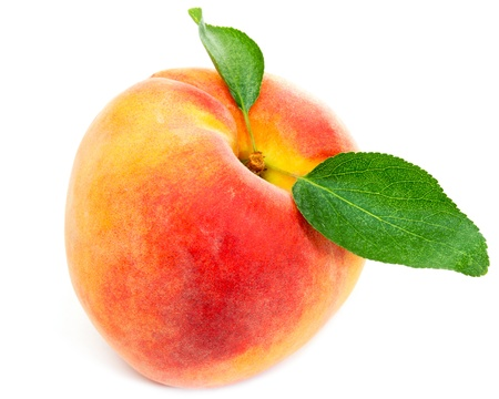 Peach with leaves isolated on white background