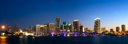 Downtown Miami skyline panorama and Biscayne Bay at dusk