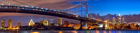 Philadelphia skyline panorama and Ben Franklin Bridge at dusk, US