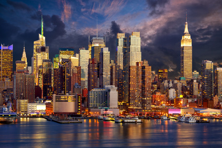 Manhattan Midtown skyline at twilight over Hudson River, New York City