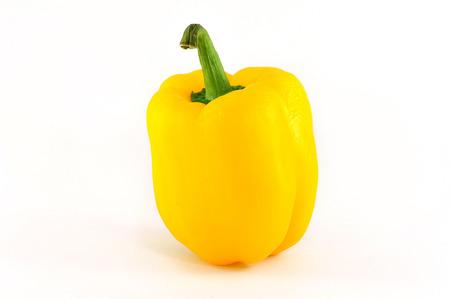 Yellow chilli on white backround