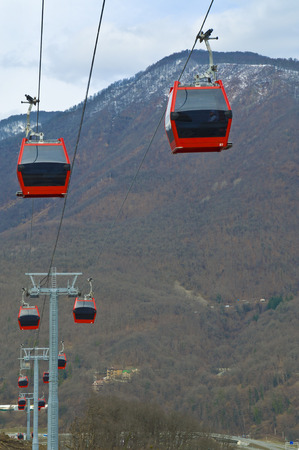 Ski lift cableway with red cabs