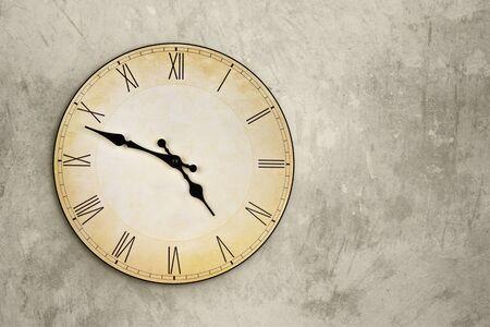 Vintage wall clock over grey grunge background