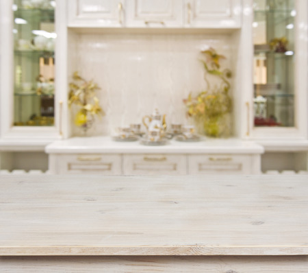 Photo for Bleached wooden table on defocused white kitchen furniture background - Royalty Free Image
