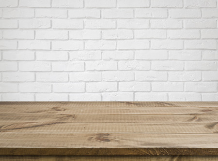 Photo pour Rough wooden texture table over defocused white brick wall background - image libre de droit