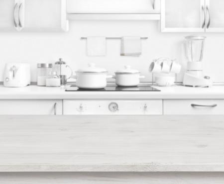 Photo pour Wooden table on white modern kitchen interior background, pastel colors - image libre de droit