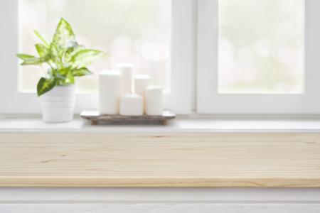 Foto de Wooden table over blurred window sill background for product display - Imagen libre de derechos