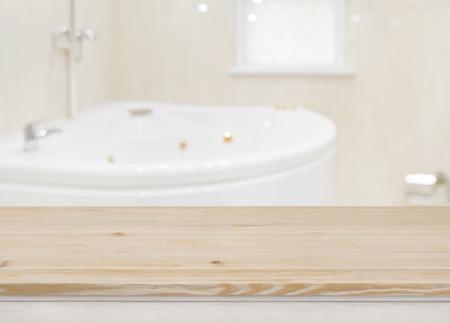 Foto für Wooden table for product display over defocused bathtub background - Lizenzfreies Bild