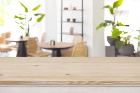 Photo pour Wood table top on defocused restaurant or coffee shop background - image libre de droit