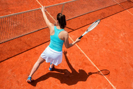 Photo for Female tennis player on the net, tennis practice - Royalty Free Image