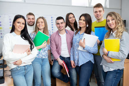Photo for Young people in classroom posing for a picture together, student concept - Royalty Free Image
