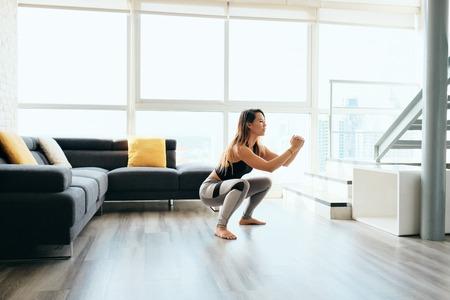 Photo pour Adult Woman Training Legs Doing In and Out Squat - image libre de droit