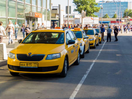 MOSCOW, RUSSIA - MAY 27, 2018: New Yellow Taxis in front of the  Kursky railway station.