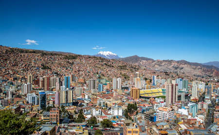 Aerial view of La Paz city with Illimani Mountain on background - La Paz, Bolivia